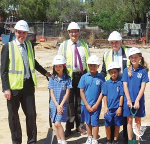• Peter Collier, Michael Sutherland, school principal Don Barba and some child labourers they rustled up. Photo supplied