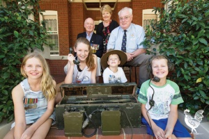 • Jan Wilkie, Cr Rod Willox and Graham McEwan from the WA Army Museum watch as Ms Wilkie's grandchildren Jayde, Jake, Grace and Tyson muck around with the rare military radio before it heads off to the museum. Photo by Matthew Dwyer