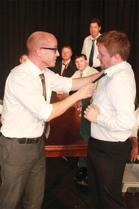 • Warren McGrath wrestles with Garry Davies in a local production of Twelve Angry Men.