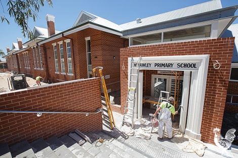 •  Workers put finishing touches to the rebuilt Mt Lawley Primary School, including the restored facade. A funkier side to the historic school. Photos by Matthew Dwyer