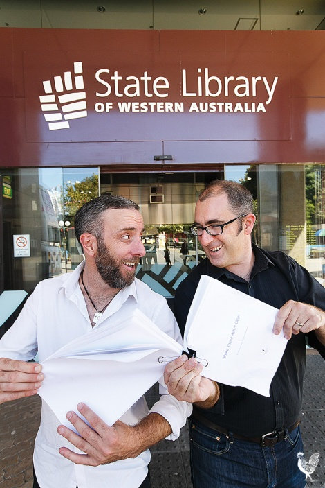 • Nathan Hondros and Damon Lockwood argue about the premier's book awards. PhotobyMatthewDwyer