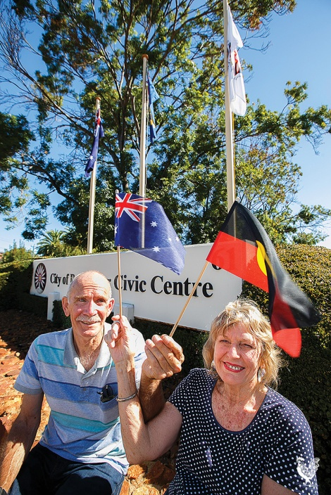 • Jan Wheare and Roger Tomlins want the Aboriginal and Torrest Strait Islander flag flying every day. Photo by Matthew Dwyer