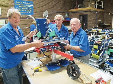 • Local Rotarians put together wheelchairs for kids.