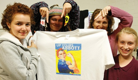 """• The Socialist Alliance with their last """"Up Yours Abbott"""" t-shirt — going for a song. Photo supplied"""