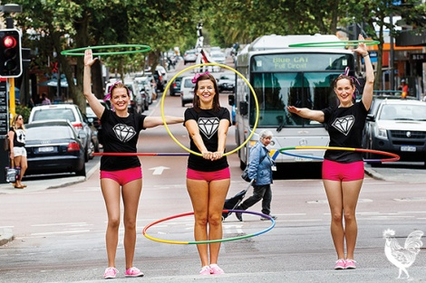 """• Happy Healthy Hoop Troop members Haley Newton, Bree Kirk-Burnnand and Katie Marshall are performing to """"cheesy"""" 1980s and '90s music at the Pride Fest parade this week.Photo by Matthew Dwyer"""