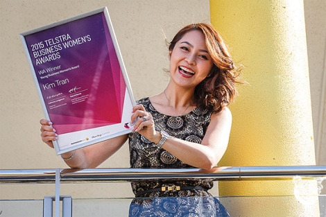 • La Belle Peau beauty clinic owner Kim Tran at home with her Telstra WA young business woman of the year award. Photos by Matthew Dwyer