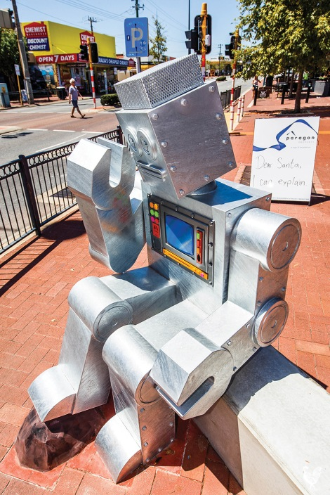 "• This robot by Si Hummerston, an example of ""good work"" put up by Vincent council, perhaps ponders why he sits opposite some less thrilling art. Photo by Matthew Dwyer"