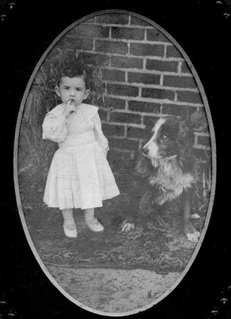 •Two year old Len Brennan with Bruce the Golden West guard dog back in 1909.