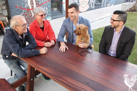 • Long-time residents Geoff Cooper and Geraldine Box chat with newish mayor John Carey and CEO Len Kosova about the city's soaring popularity. Photo by David Bell