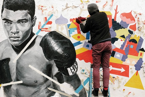 • Brolga at work on his Muhammad Ali portrait.