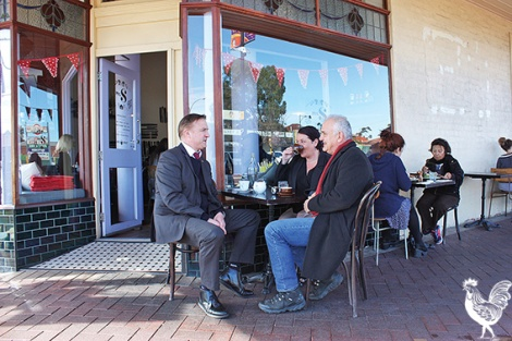 • Crs Chris Cornish and Catherine Ehrhardt discuss Bayswater's easing of alfresco laws over a cuppa with Lyric Lane owner Michiel de Ruyter. Photo by Steve Grant