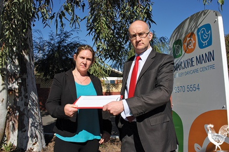 • Simon Millman hands over his petition to Marjorie Mann's Shelley Carlin.