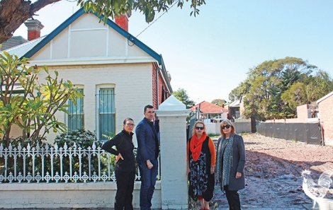 • Mayor John Carey and Harley Street's Roz Hughes, Janine Wells and Toni Gibbs lament the new gap in their old-style streetscape. They fear it's a long-term neighbour now. Photo by Steve Grant