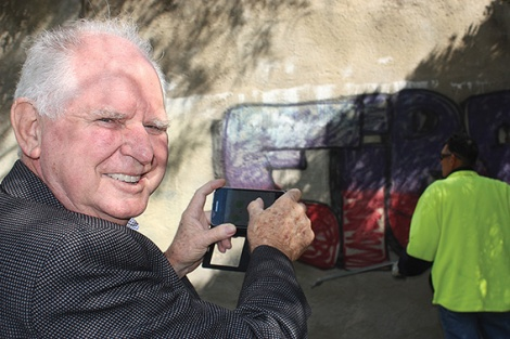• Bayswater councillor Alan Radford says reporting graffiti with a smartphone app will let Paul Lazaridis and the rest of the maintenance crew get there quick to rub it out.