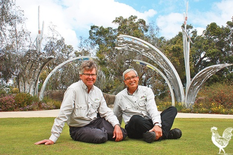 • Kings Park's senior curator Grady Brand and curator Peter Nguyen strike a pose under the new sculpture while the park blooms around them. Photo by Steve Grant