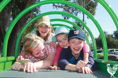 • Bayswater deputy mayor Stephanie Coates with Claudia, Esther and Oliver on Bardon Park's new roller table. Photo by Steve Grant