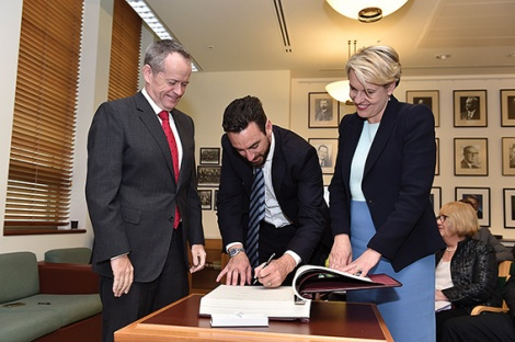 • Tim Hammond gets sworn in as a shadow minister, flanked by Bill Shorten and Tanya Plibersek.
