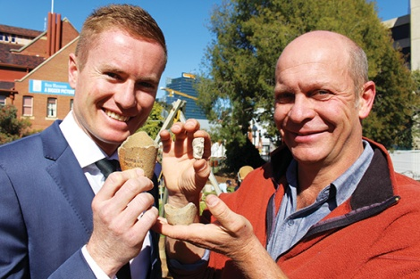 • WA heritage minister Albert Jacob with UWA archaeologist Sven Ouzman. They're holding artefacts uncovered in a dig around the WA museum: two imported crucibles used in the old geological laboratory to smelt down minerals, and the bowl of a clay pipe found in the old gaol site. Photo supplied.