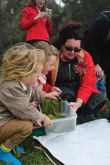 • The wee turtles being released by Deborah Bowie and kids Jane and Alex. PhotobyBrettKlucznik