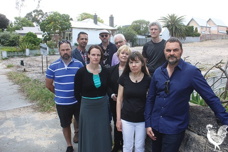 •This group of Highgate residents are outraged that a five-storey apartment complex is being considered for their quiet street. Photo by Steve Grant