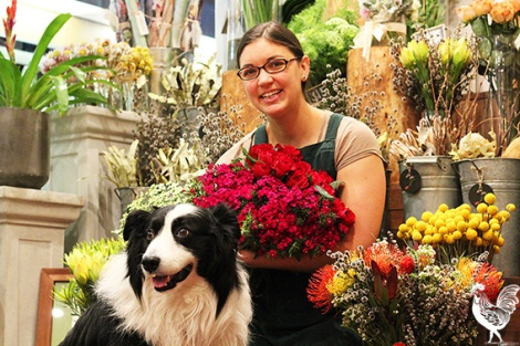 • Stacey Lenstra and shop pooch Bobby run an earth-friendly flower store. Photo by Trilokesh Chanmugan