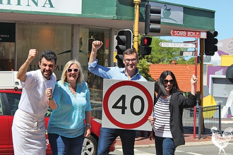 •Mt Hawthorn locals Mario Tolardo, Alex Castle, and Elle Gonzales-Skuja celebrate the implementation of a 40km speed-limit through the town centre with Vincent Mayor John Carey. Photo by Trilokesh Chanmugam