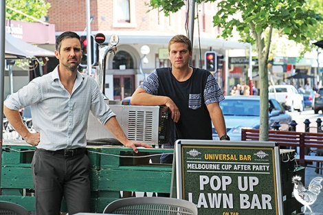 • Universal bar owners Trevor Candido and Jason Juraszek in their alfreso area pop-up for Melbourne Cup. Photo by Steve Grant