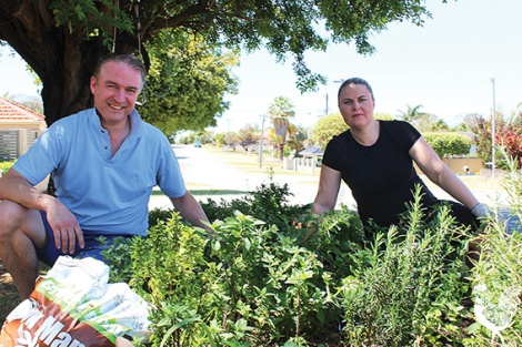 • Chris and Della Cornish tending their verge garden. Photo by Trilokesh Chanmugam