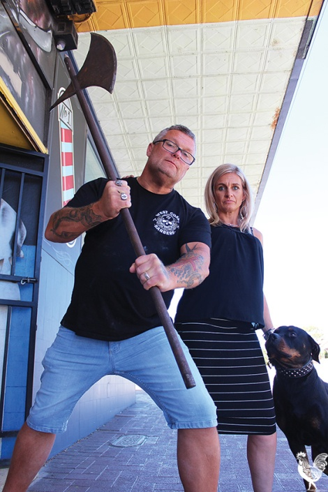 • With The Chop Shop itself facing the axe, barber shop owners Andy and Marianne Bondarenko (with attack dog Boris) say they'll not stand idly by. Photos by Trilokesh Chanmugam