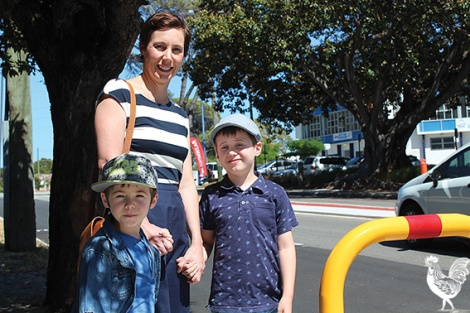 • Vincent mayoral candidate Emma Cole with her youngens Eddie and Conor stranded in the narrow Vincent Street median strip. Photo by Trilokesh Chanmugam