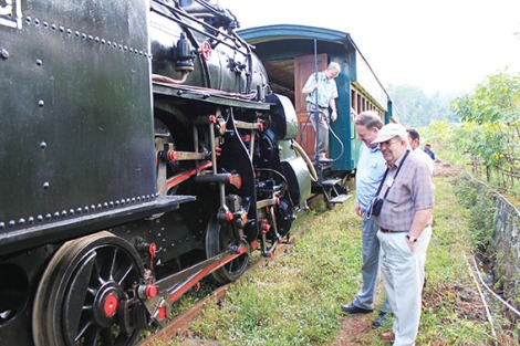 Tour leader Kevin Pearce and Murray Johnson of Cottesloe inspect the workings of the 114-year old rack locomotive.