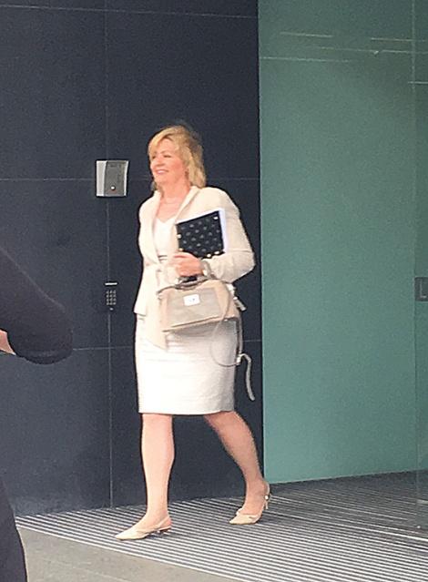 • Lisa Scaffidi leaves the SAT hearing.