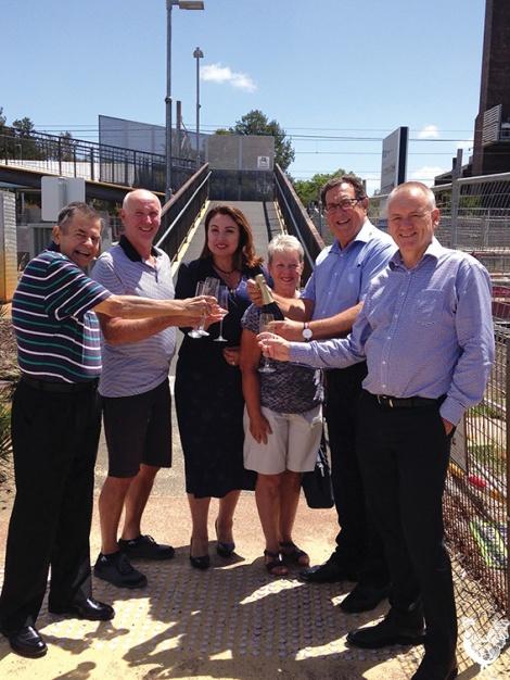 • Scottish visitors Alec and Christine Milne help celebrate the community's win with Michael Sutherland, Eleni Evangel, Kevin Burton and Michael Martin. PhotobySteveGrant