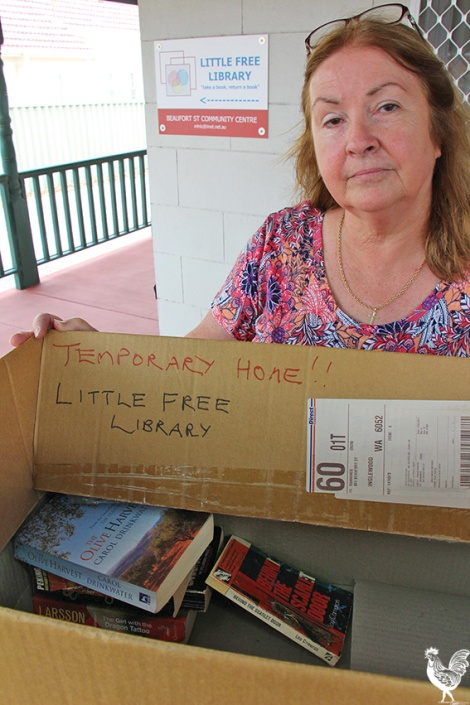 • The Beaufort Street Community Centre's manager Lindsay Payne with their makeshift library after lowlifes nicked the old one. Photo by Steve Grant